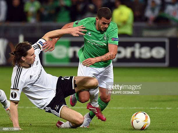 SaintEtienne's French forward Valentin Eyssenic vies with Rosenborg's Norwegian midfiellder Ole Selnaes during the Europa League football match...