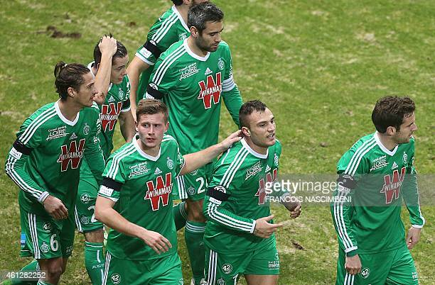SaintEtienne's French forward Yohan Mollo celebrates with teammates after scoring a goal during the French L1 football match between Reims and...