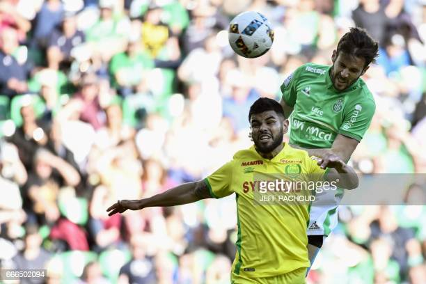 SaintEtienne's French midfielder Benjamin Corgnet scores past Nantes' Brazilian defender Lima during the L1 football match AS SaintEtienne vs FC...