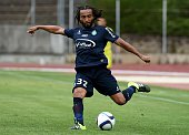SaintEtienne's French midfielder Benoit Assou Ekotto shoots the ball during the friendly football match AS SaintEtienne against Ajax Amsterdam on...