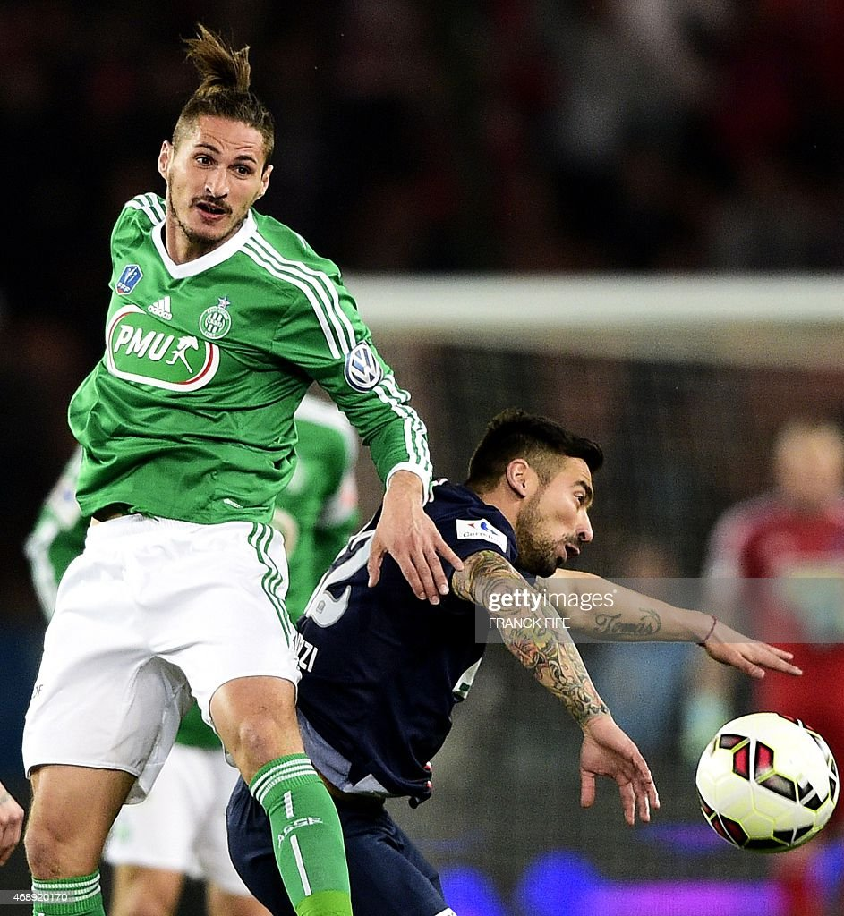 Saint-Etienne's French midfielder Jeremy Clement fights for the ball with Paris Saint-Germain's Argentinian midfielder <a gi-track='captionPersonalityLinkClicked' href=/galleries/search?phrase=Ezequiel+Lavezzi&family=editorial&specificpeople=5451126 ng-click='$event.stopPropagation()'>Ezequiel Lavezzi</a> on April 8, 2015 duirng a French Cup semi-final football match between Paris Saint-Germain (PSG) and Saint-Etienne (ASSE) at the Parc des Princes stadium in Paris.