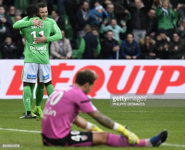 SaintEtienne's French midfielder Jordan Veretout is congratuled by teamate SaintEtienne's French midfielder Henri Saivet after scoring a goal as...