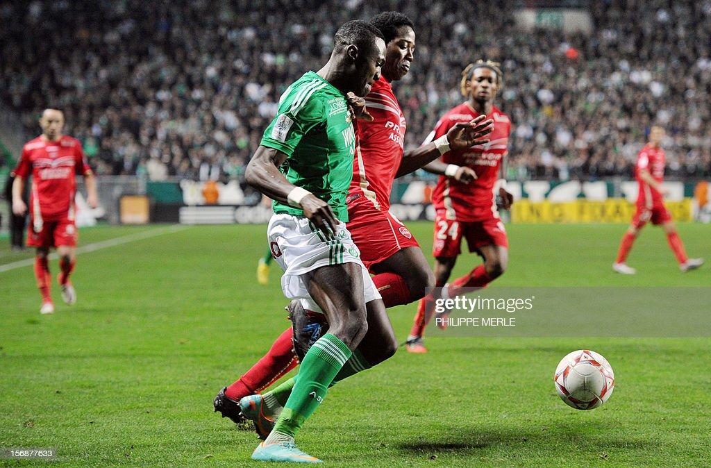 Saint-Etienne's French midfielder Josuha Guilavogui (L) fights for the ball with Valenciennes' midfielder Carlos during the French L1 football match Saint-Etienne vs Valenciennes, on November 23, 2012 at the Geoffroy-Guichard stadium in Saint-Etienne. AFP PHOTO / PHILIPPE MERLE