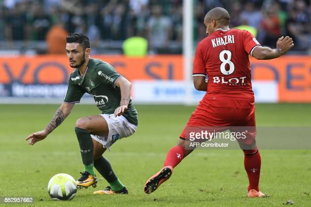 SaintEtienne's French midfielder Remy Cabella vies with Rennes' Tunisian midfielder Wahbi Khazri during the French Ligue 1 football match AS...