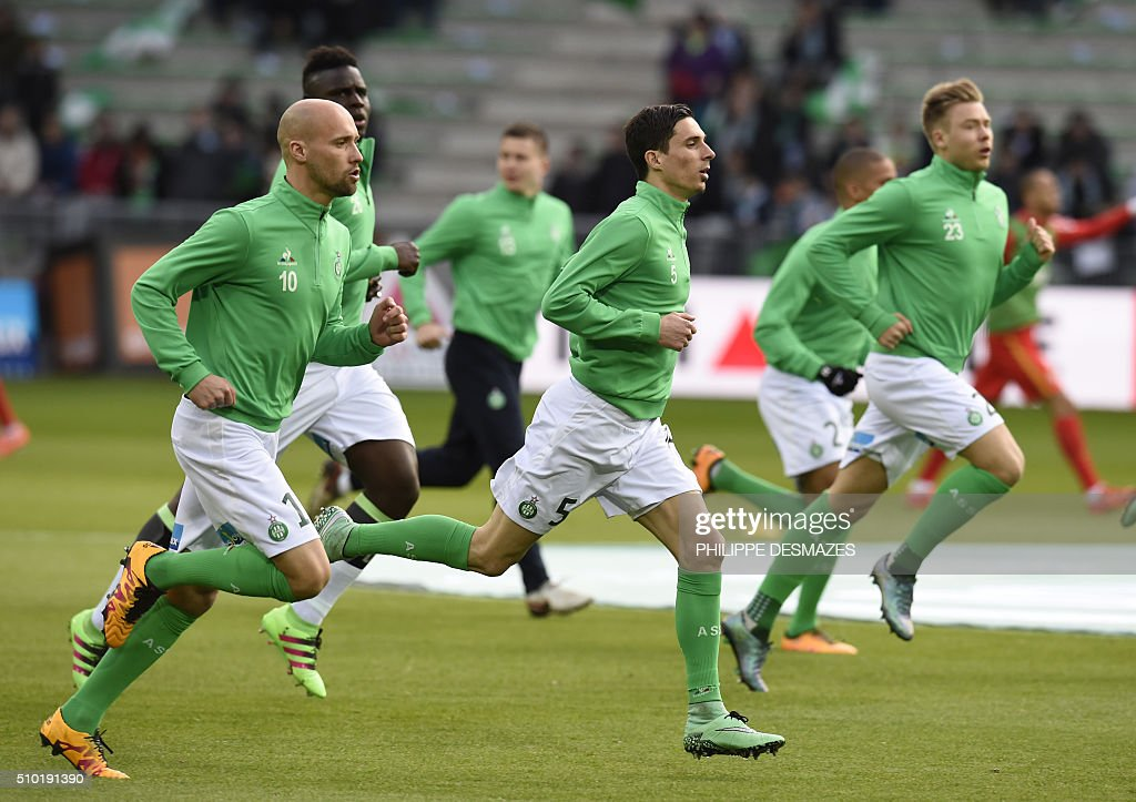 Saint-Etienne's French midfielder Renaud Cohade, Saint-Etienne's French midfielder Vincent Pajot and Saint-Etienne's French defender Paul Baysse warm up prior to the French L1 football match AS Saint-Etienne vs AS Monaco on February 14, 2016 at the Geoffroy-Guichard stadium in Saint-Etienne , central France. AFP PHOTO/PHILIPPE DESMAZES / AFP / PHILIPPE DESMAZES