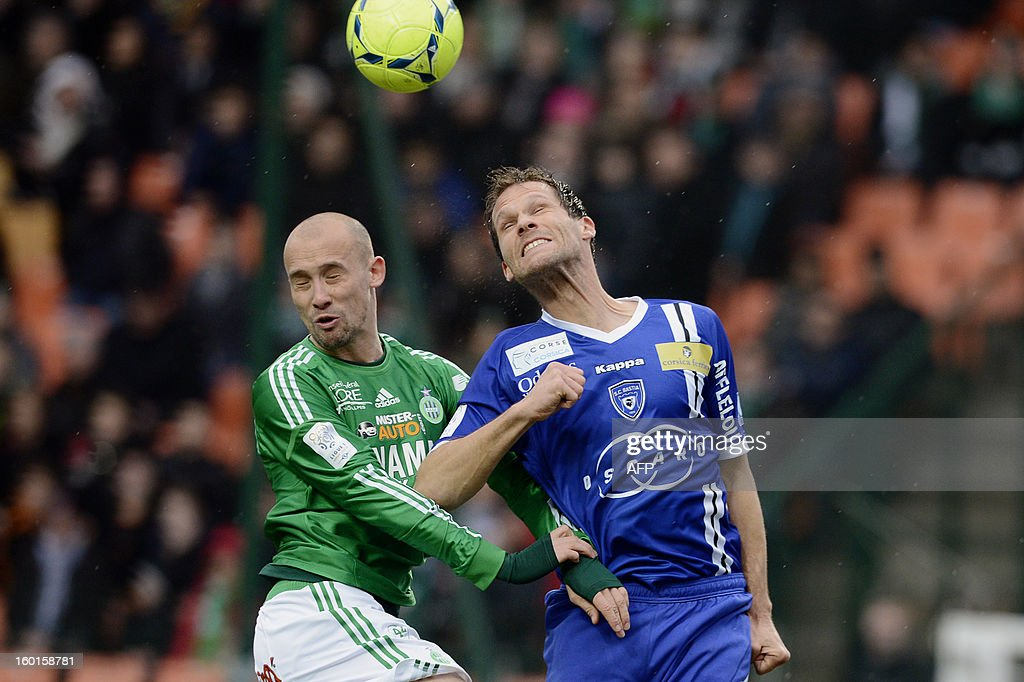 Saint-Etienne's French midfielder Renaud Cohade (L) vies with Bastia's French defender Sylvain Marchal (R) during the French L1 football match AS Saint-Etienne (ASSE) vs Bastia (SCB) on January 27, 2013, at the Geoffroy Guichard Stadium in Saint-Etienne, central France.