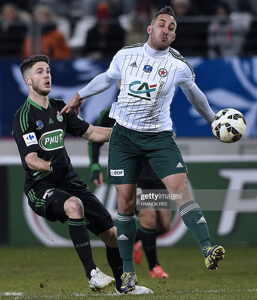 Saint-Etienne's French midfielder <a gi-track='captionPersonalityLinkClicked' href=/galleries/search?phrase=Renaud+Cohade&family=editorial&specificpeople=2626266 ng-click='$event.stopPropagation()'>Renaud Cohade</a> (L) vies with Red Star's defender Romuald Marie during the French Cup football match Red Star vs AS Saint-Etienne (ASSE) at the Jean Bouin stadium in Paris on February 10, 2015. AFP PHOTO / FRANCK FIFE