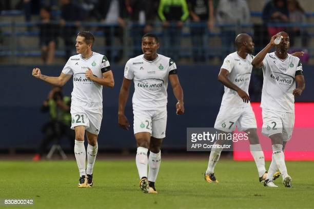 SaintEtienne's French midfielder Romain Hamouma celebrates with teammates after scoring during the French L1 football match between Caen and...