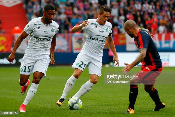 SaintEtienne's French midfielder Romain Hamouma drives the ball during the French L1 football match between Caen and SaintEtienne on August 12 at the...