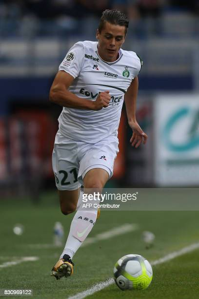 SaintEtienne's French midfielder Romain Hamouma runs with the ball during the French L1 football match between Caen and SaintEtienne on August 12 at...