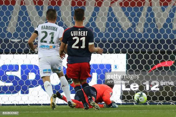 SaintEtienne's French midfielder Romain Hamouma scores a goal during the French L1 football match between Caen and SaintEtienne on August 12 at the...