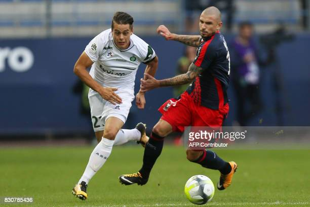 SaintEtienne's French midfielder Romain Hamouma vies with Caen's French midfielder Vincent Bessat during the French L1 football match between Caen...