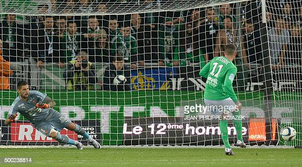 SaintEtienne's French midfielder Valentin Eysseric scores on a penalty kick during the French L1 football match SaintEtienne vs Rennes on December 06...
