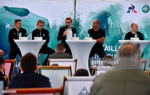SaintEtienne's French President Roland Romeyer is watched by SaintEtienne's Spanish head coach Oscar Garcia and SaintEtienne's French former player...