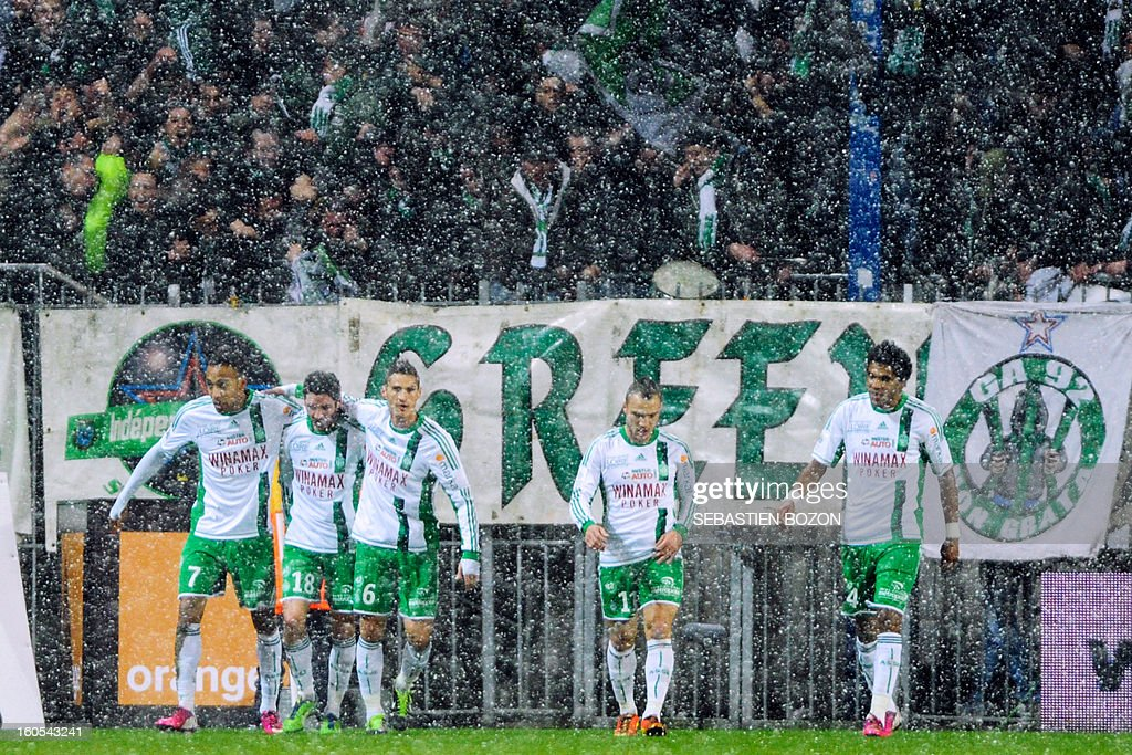 Saint-Etienne's Gabonese forward Pierre-Eme Aubameyang (L) celebrates with team mates after scoring a goal during a French L1 football match between Sochaux (FCSM) and Saint-Etienne (ASSE) at the August Bonal Stadium in Montbeliard on February 2, 2013.