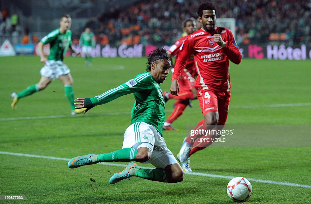 Saint-Etienne's Gabonese forward Pierre-Eme Aubameyang (L) fights for the ball with Valenciennes' Brazilian defender Carlos Gil during the French L1 football match Saint-Etienne vs Valenciennes, on November 23, 2012 at the Geoffroy-Guichard stadium in Saint-Etienne.