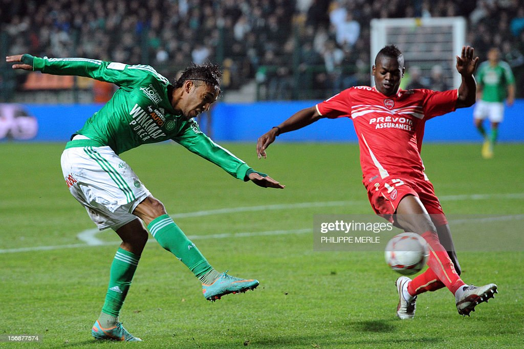 Saint-Etienne's Gabonese forward Pierre-Eme Aubameyang (R) fights for the ball with Valenciennes' French defender Nicolas Isimat-Mirin during the French L1 football match Saint-Etienne vs Valenciennes, on November 23, 2012 at the Geoffroy-Guichard stadium in Saint-Etienne.