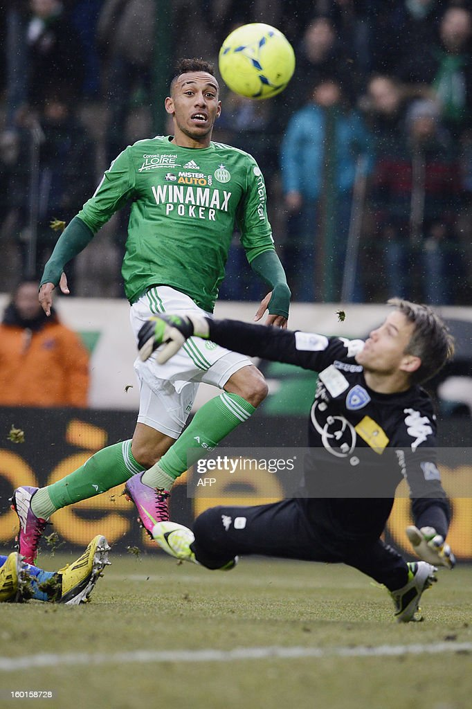 Saint-Etienne's Gabonese forward Pierre-Emerick Aubameyang (L) tries to score despite Bastia's French goalkeeper Mickael Landreau (R) during the French L1 football match AS Saint-Etienne (ASSE) vs Bastia (SCB) on January 27, 2013, at the Geoffroy Guichard Stadium in Saint-Etienne, central France.