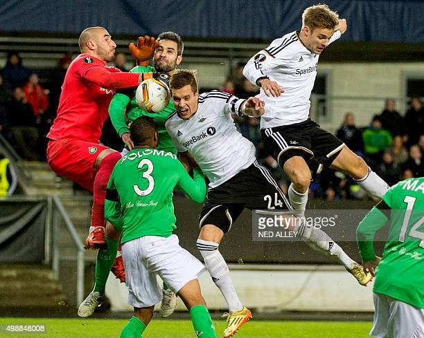 SaintEtienne's goalkeeper Stephane Ruffier and Rosenborg's Anders Konradsen vie for the ball during the UEFA Europa League football match Rosenborg...