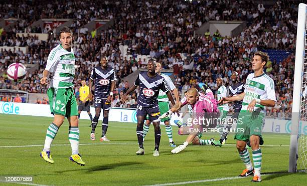 SaintEtienne's goalkeeper Stephane Ruffier dives next to Bordeaux' Malian midfielder Abdou Traore during the French L1 football match Bordeaux vs...