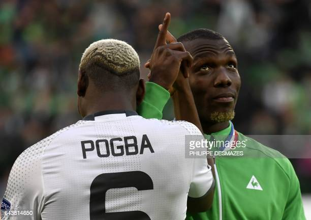 TOPSHOT SaintEtienne's Guinean defender Florentin Pogba shakes hands with his brother Manchester United's French midfielder Paul Pogba during the...