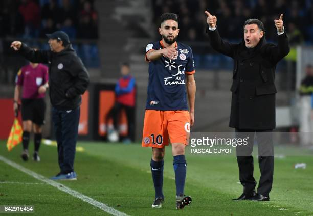 SaintEtienne's head coach Christophe Galtier reacts next to Montpellier's French midfielder Ryad Boudebouz during the French L1 football match...