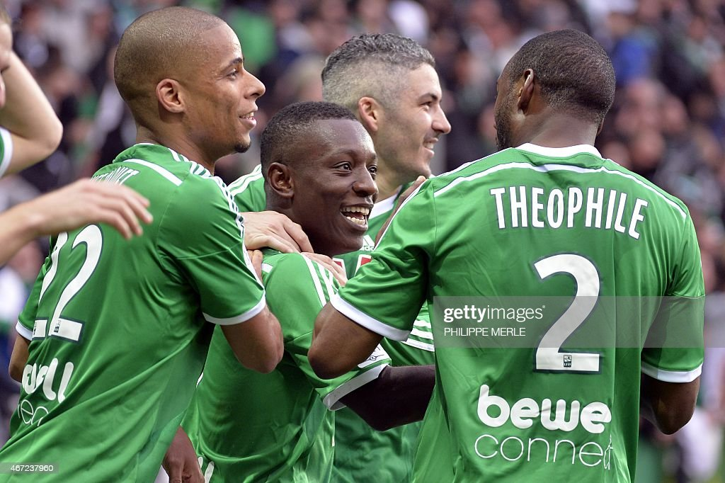 Saint-Etienne's Ivorian forward Max-Alain Gradel (C) celebrates with his teammates, French forward <a gi-track='captionPersonalityLinkClicked' href=/galleries/search?phrase=Kevin+Monnet-Paquet&family=editorial&specificpeople=4044138 ng-click='$event.stopPropagation()'>Kevin Monnet-Paquet</a> (L), French midfielder <a gi-track='captionPersonalityLinkClicked' href=/galleries/search?phrase=Fabien+Lemoine&family=editorial&specificpeople=4784581 ng-click='$event.stopPropagation()'>Fabien Lemoine</a> (Rear) and French defender Kevin Theophile-Catherine after scoring during the French L1 football match Saint-Etienne (ASSE) vs Lille (LOSC) on March 22, 2015 at the Geoffroy-Guichard stadium in Saint-Etienne.