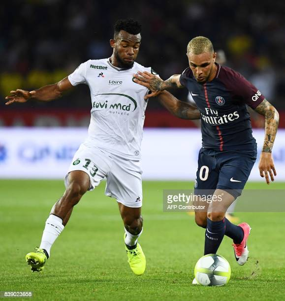 SaintEtienne's Ivorian midfielder Habib Maiga vies for the ball with Paris SaintGermain's French defender Layvin Kurzawa during the French L1...