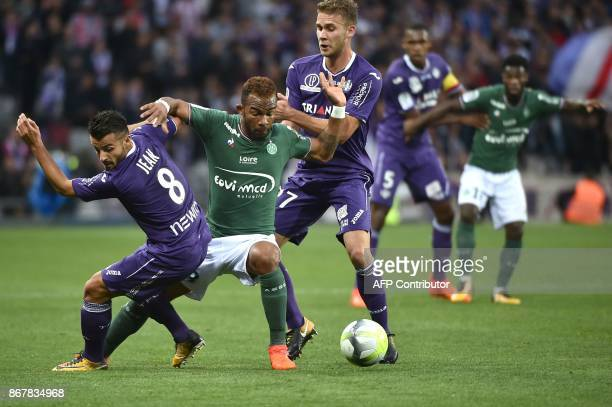 SaintEtienne's Ivorian midfielder Habib Maiga vies for the ball with Toulouse's French forward Corentin Jean during the French L1 football match...