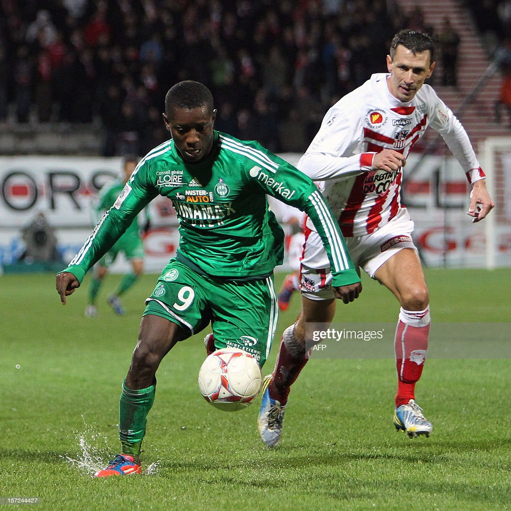 Saint-Etienne's Ivorian midfielder Max Alain Gradel (L) vies with Ajaccio's French defender Yohan Poulard during the French L1 football match Ajaccio (ACA) vs Saint-Etienne (ASSE) in the Francois Coty stadium in Ajaccio, French mediterranean island of Corsica, on November 30, 2012.