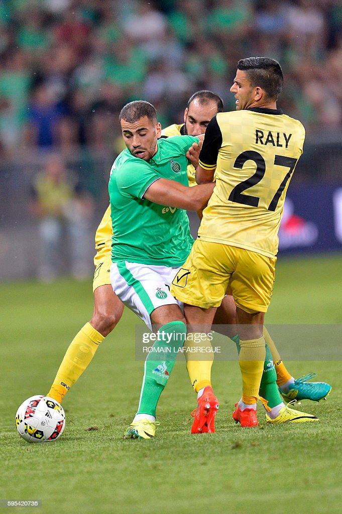 SaintEtienne's Moroccan forward Oussama Tannane vies with Beitar Jerusalem's Israeli midfielder Oz Rali during the UEFA Europa League playoff...