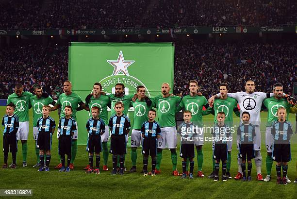 SaintEtienne's players stand during the French national anthem in tribute to the victims of Paris attacks prior to the French Ligue 1 football match...
