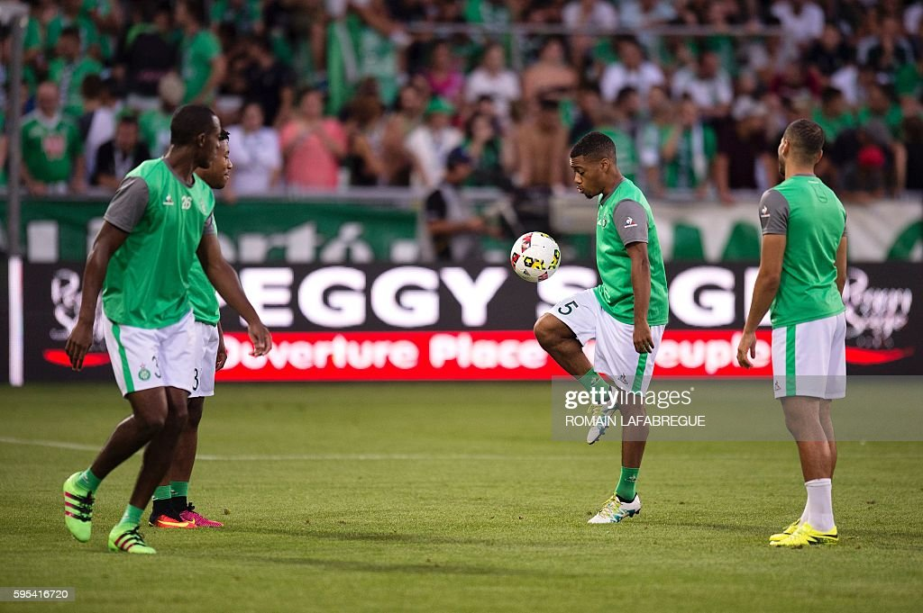SaintEtienne's players warm up before the UEFA Europa League playoff football match between AS SaintEtienne and Beitar Jerusalem at the...