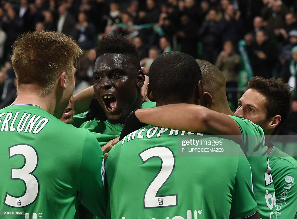 Saint-Etienne's Senegalese defender Moustapha Bayal Sall (2nd R) is congratulated by teammates after scoring a goal during the French Ligue1 football match between AS Saint-Etienne and AS Monaco, on February 14, 2016 at the Geoffroy Guichard stadium in Saint-Etienne , central France. AFP PHOTO/PHILIPPE DESMAZES / AFP / PHILIPPE DESMAZES