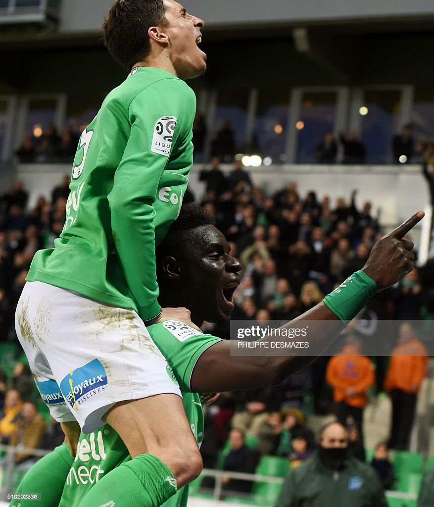 Saint-Etienne's Senegalese defender Moustapha Bayal Sall (down) is congratuled by teammate Saint-Etienne's French midfielder Vincent Pajot (up) after scoring during the French Ligue1 football match between AS Saint-Etienne and AS Monaco, on February 14, 2016 at the Geoffroy Guichard stadium in Saint-Etienne , central France. AFP PHOTO/PHILIPPE DESMAZES / AFP / PHILIPPE DESMAZES