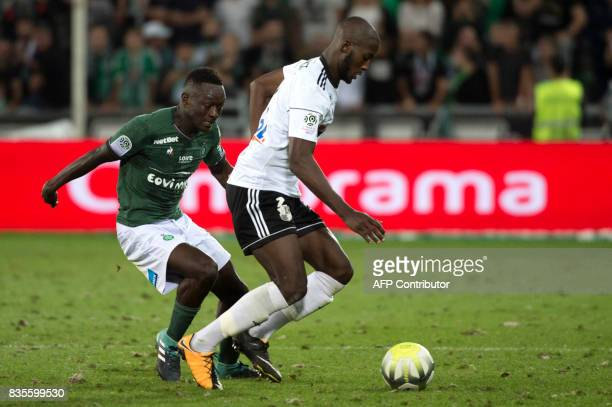 SaintEtienne's Senegalese midfielder El Hadji Diouf vies with Amiens' French defender Prince Desir Gouano during the French L1 football match between...