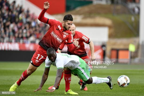 SaintEtienne's Senegalese midfielder Henri Saivet vies with Dijon's FrenchAlgerian midfielder Mehdi Abeid during the French L1 football match Dijon...