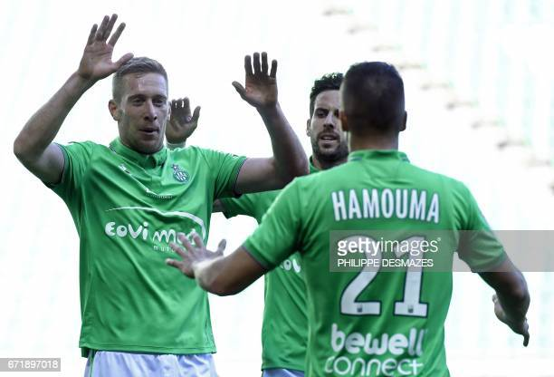 SaintEtienne's Slovenian forward Robert Beric celebrates with teammates SaintEtienne's French midfielder Benjamin Corgnet and SaintEtienne's French...