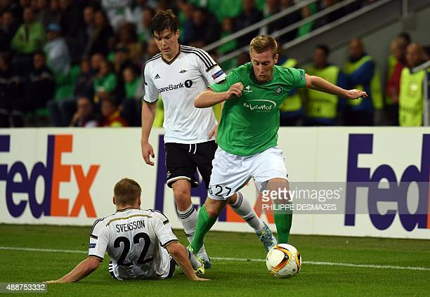 SaintEtienne's Slovenian forward Robert Beric vies with Rosenborg's Norwegian defender Pal Andre Helland and Rosenborg's Norwergian midfielder Jonas...