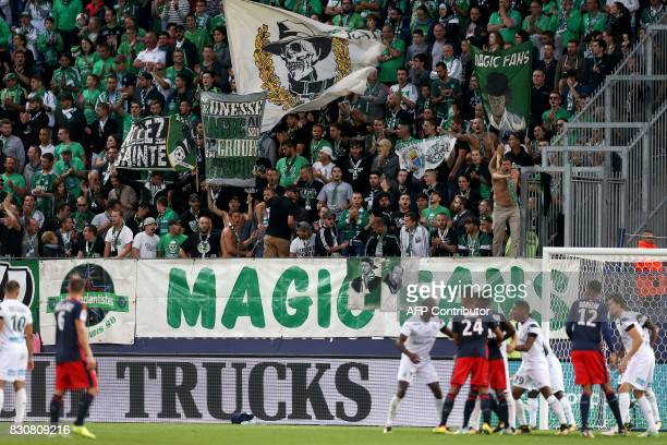 SaintEtienne's supporters cheer for their team during the French L1 football match between Caen and SaintEtienne on August 12 at the Michel d'Ornano...