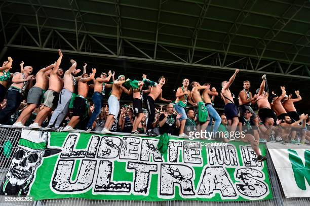 SaintEtienne's supporters cheer for their team during the French L1 football match between SaintEtienne and Amiens on August 19 at the Geoffroy...