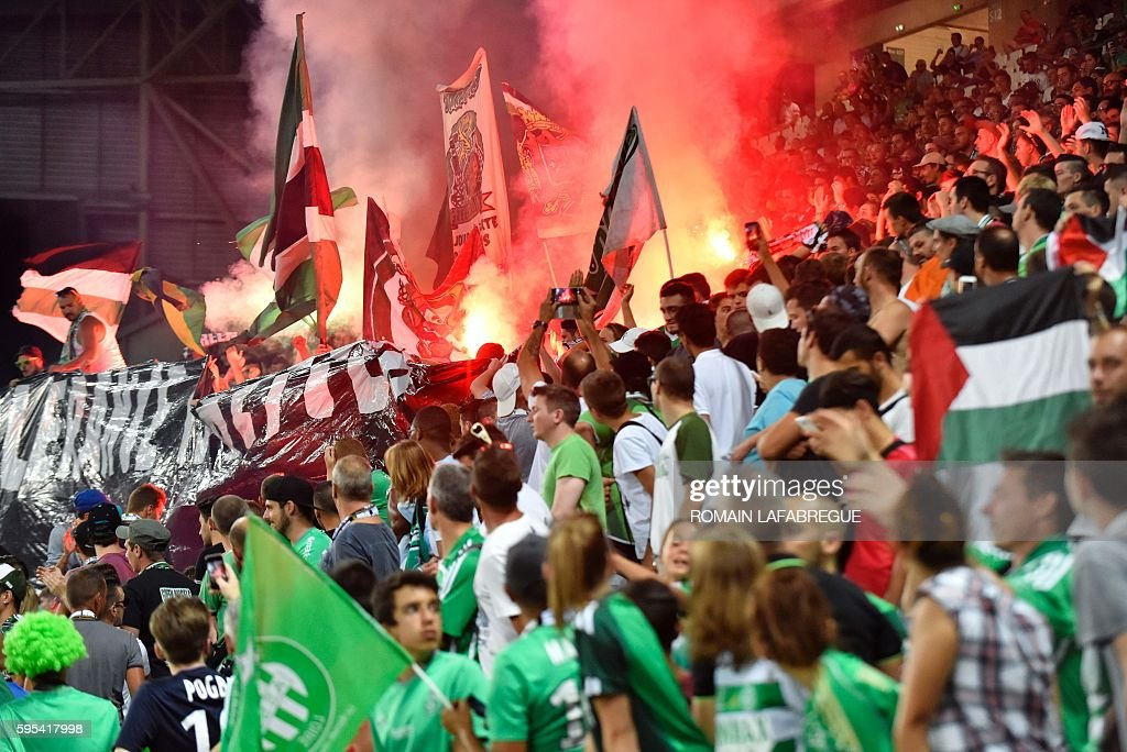 SaintEtienne's supporters wave Palestine's flag and cheer during the UEFA Europa League playoff football match between AS SaintEtienne and Beitar...