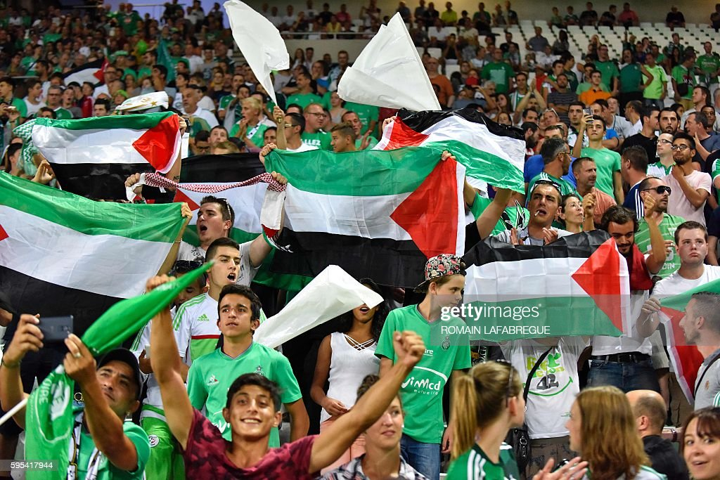 SaintEtienne's supporters wave Palestine's flag during the UEFA Europa League playoff football match between AS SaintEtienne and Beitar Jerusalem at...