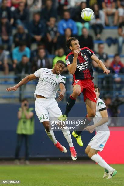 SaintEtienne's Swiss defencer Sandy Janko vies with Caen's Croatian forward Ivan Santini during the French L1 football match between Caen and...