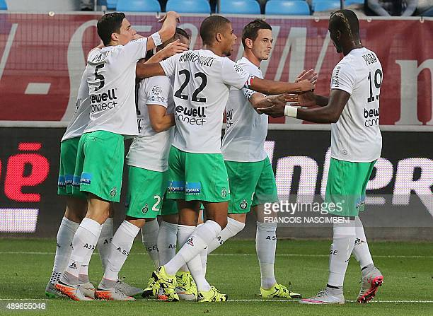 SaintEtienne's teammates celebrate after SaintEtienne's French midfielder Benjamin Corgnet scored a goal during the French L1 football match between...