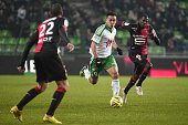 SaintEtienne's Turkish forward Mevlut Erding runs with the ball despite Rennes' French midfielder Abdoulaye Doucoure and defender Sylvain Armand...