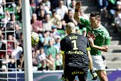 SaintEtienne's Turkish forward Mevlut Erding vies with Nantes' French goalkeeper Remy Riou during the French L1 football match SaintEtienne vs Nantes...