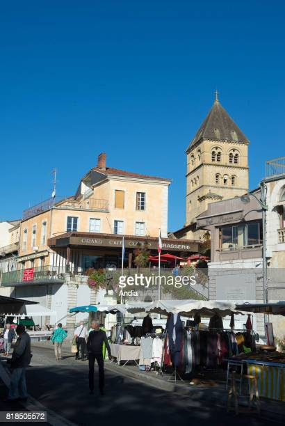 SaintGaudens Market in the town centre in summer at the bottom of the Romanesque Collegiate Church of St St Peter and St Gaudens registered as a...