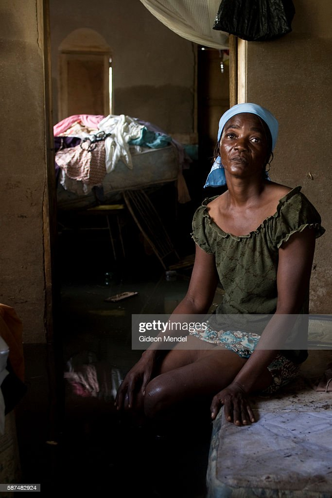 Saintil Jerone faces the camera inside her flooded home in Savanne Desole on the outskirts of the city of Gonaives She had lost most of her...