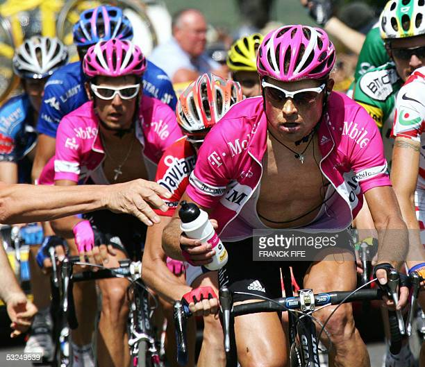 German Jan Ullrich rides in front of his teammate German Andreas Kloden during the 15th stage of the 92nd Tour de France cycling race between...